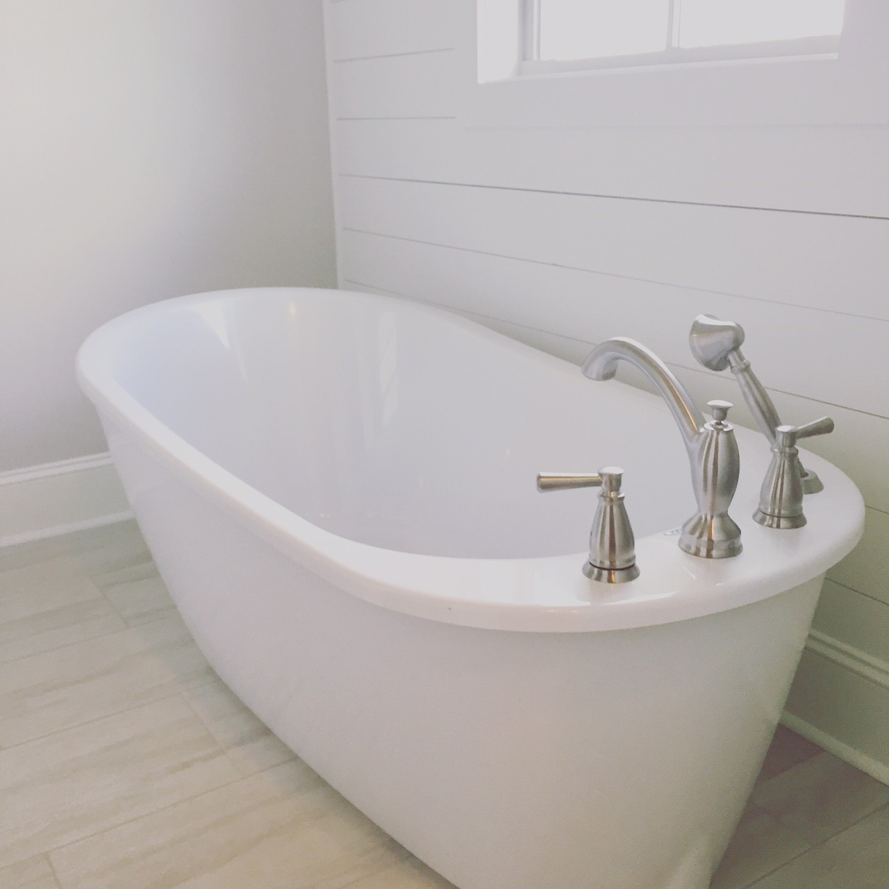 Tub space courtyard collection the waters al - Deep tub for small space collection ...