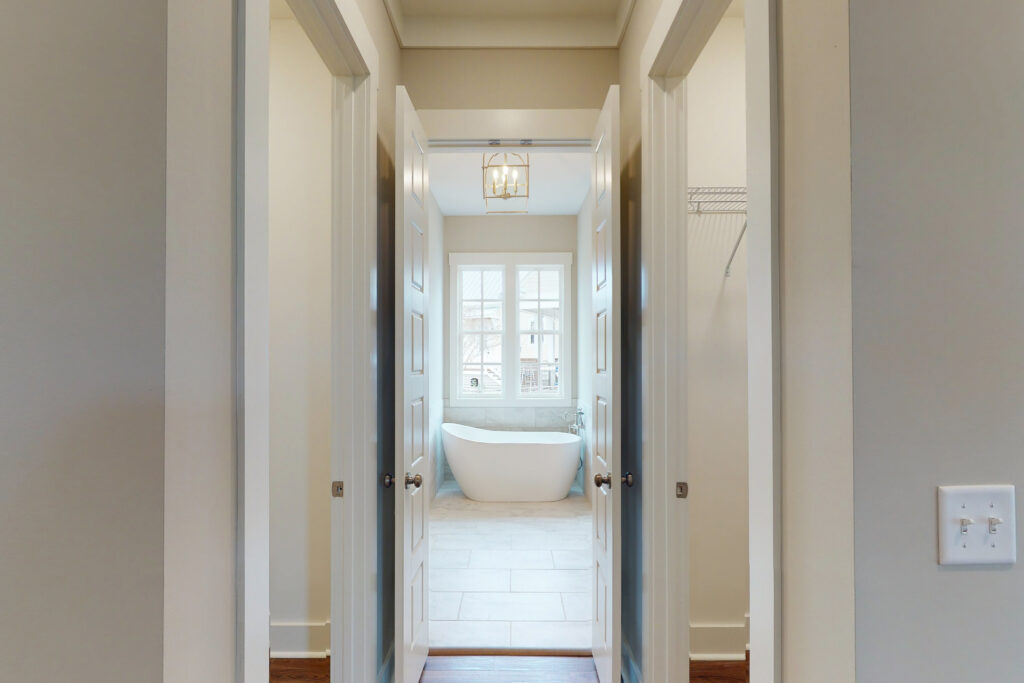 The Pearl | French door entrance to master bath